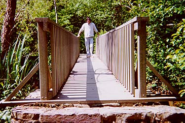 Meghan-Dad Walking Across Recycled Bridge